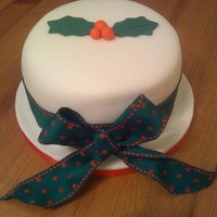 "Christmas Cake 6"" Fruit cake covered in marzipan and sugarpaste."
