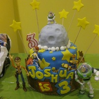 Toy Story 3 Cake I found a few pictures of this cake design online and duplicated it on my own. This was my first attempt at a fondant, tiered cake made for...