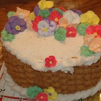 Basket Weave Cake Oval cake, Buttercream icing, Brown Basket Weave, with white Rope along the border, and some royal per made flowers.....