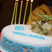 Star Wars Master Yoda Cake This is my firt cake using fondant ever - but I had a blast doing it. Got the fondant readymade off the internet and loved working with it...