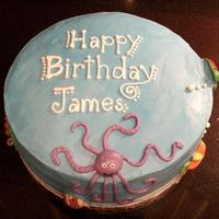 Under The Sea Cake yellow cake with raspberry filling and vanilla buttercream frosting and marshmallow fondant and chocolate decorations.