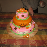 Pumpkin Theme First Birthday Cake This is a three tiered birthday cake that I made for my daughter's first birthday. The top tier is sour cream pound cake, the middle...