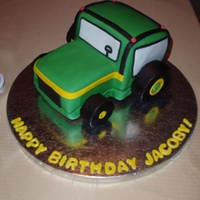 John Deere Tractor Chocolate covered with fondant. RKT wheels. Cupcakes with chocolate tractors made with candy melts.