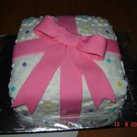 Package First experience with fondant. It is a plain white cake with buttercream icing and fondant.