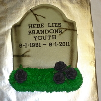 Here Lies Your Youth! buttercream icing, royal icing roses, fondant letters, and some airbrushing!