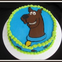 Scooby Doo A chocolate cake covered with buttercream with fondant Scooby Doo. I made this for my kids birthday cake. They share the same birthday...