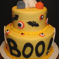 Boo!   I was asked to donate a cake as a prize in a Halloween-themed fundraiser and this is what I came up with. All decorations are MMF.