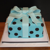 Polka Dot Gift Cake  This cake was based on the adorable shower invites. Inside was three layers of vanilla sponge cake filled with a rich and creamy chocolate...