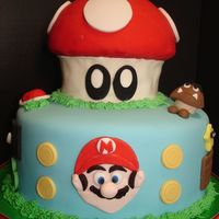 "Super Mario Birthday Cake The bottom cake is a 10"" round; the top of the mushroom is 1/2 of a ball pan; and the stem of the mushroom is the bottom of the Wilton..."