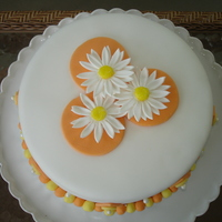 Modern Daisy Cake  I did this cake a while back for a book club get together. The daisies are made of gumpaste; the other accents are made of fondant and...