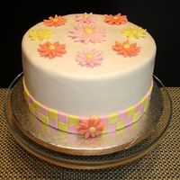 Checkerboard Daisy  I made this cake for a small bridal luncheon. The daisies were made with a fondant/gum text mixture. The cake was a classic white cake with...