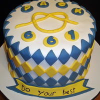 Cub Scout Cake This Cub Scout theme cake was done for my son's Blue & Gold Banquet. The overhand knot was made by extruding fondant through a...