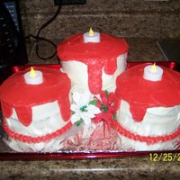 Christmas Candles   Pepermint flavoring cake with vanilla frosting and edible poinsettas