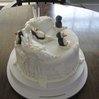 Penguin Cake fondant cake with details of frosting