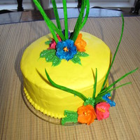 Something Hawaii Frosting cake with gumpaste flowers and grass