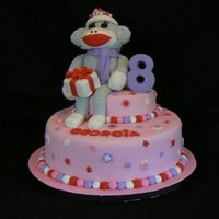 Sock Monkey   Cake is vanilla with vanilla buttercream. Sock monkey is rkt covered in fondant.
