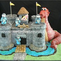 Castle   Castle is cake, towers and dragon are rkt. All covered in fondant.