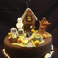Haunted House   House and tree are made from rkt. All decorations covered in gumpaste/fondant