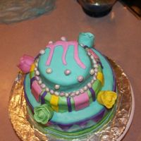 Funky Cake  Pearls are on top with the first letter of the bday girl, stripes on the middle layer with roses protruding from the sides, and Vs on the...
