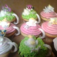 Teacup Cupcakes french vanilla cupcakes with butterream icing and fondant accents for the handle i hand rolled out and little fondant with flowers