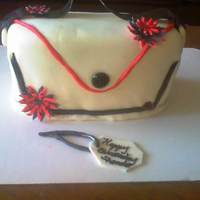 Purse vanallia cake with buttercream and fondant and fondant flowers
