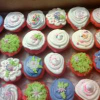 Flower Cupcakes strawberry cupcakes with butter cream icing and fondant flowes