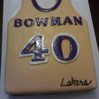 Lakers Jersey this was a half sheet cake i hand carved marble cake with buttercream and than coverd in fondant and the name and numbers are painted with...