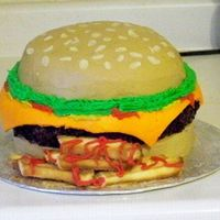 "Cheeseburger And Fries This was my first ""theme"" cake. Vanilla ""buns"", a chocolate ""burger"", marshmallow fondant cheese and a lot of..."
