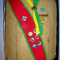 Scout Uniform This 12 x 18 monster has chocolate filling, fondant decorations and looked much better in person. :)