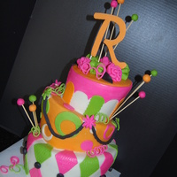Whimsical Topsey Turvey 3 tier whimsical topsey turvey cake, ganach shell under fondant covered layers with fondant accents