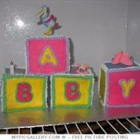 Blocks This was one of the first cakes that I ever made. I had never taken any classes or read anything on decorating. Just decided to try my hand...