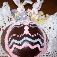 Easter Egg Cake Poured chocolate ganache over the half easter egg and decorated on the lines that still showed through. Fun cake