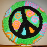 Peace Of Cake   This was a quick cake needed to be done in just a day. The little girl wanted peace signs and I chose the funky colors. She loved it.