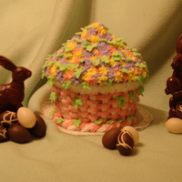 Happy Easter Chocolate cake with basket weave and flowers for an Easter basket full of flowers