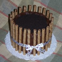 Chocolate Hazlenut Pirouette Cake  I made this cake for my church. It is a two layer chocolate cake with peanut butter ganache in the middle and on top. The top ganache is...