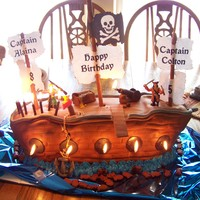 "Pirate Ship Cake The Pirate Ship Cake I made for my son and daughter's 5th & 8th Birthdays. It started to ""sink"", but we made it through..."