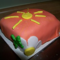 Sunshine Cake My 8 year old daughter's first ever fondant cake! She did it completly by herself, I was busy making my first ever wedding cake. I am...