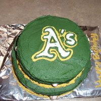 Oakland A's Cake   White cake with vanilla butter cream. Oakland A's theme. I did the logo free hand.