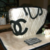 Chanel Bag silver and black chanel bag.madiera sponge cake with chocolate buttercream filling for the 21st birthday girl.TFL