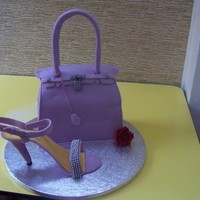 Hermes Berkin Bag madeira cake with ganache filling covered with fondant,the handle and the shoe were made of homemade gumpaste.shoe accent is silver dragees...