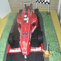 Ferrari Cake madeira cake with ganache filling.fondant and gumpaste accents.it took me three days to complete the design it was hard to make this car...