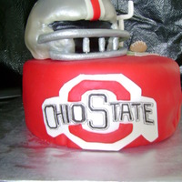Ohio State 10 inch whit cake with strawberry mousse filling, helmit carved white cake with strawberry mousse filling, both covered wth buttercream...