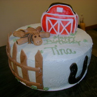 Farm Birthday Cake chocolate cake covered in bc, barn is rk covered in fondant, fence, horseshoe and horse are fondant