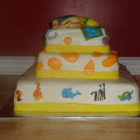 Alphabet Soup Bedding Cake This cake was designed to look like the bedding the baby will have. It is called Alphabet soup. All fondant work. Handmade baby rump topper...