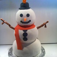 Snowman   Should have put a sode bottle beside it, this cake is about 2 feet high! All fondant except the arms, which are tootsie rolls.