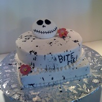 Bite Me   Edgy birthday cake for my young, hip, edgy daughter in law. All buttercream with 2 gumpaste flowers and a fondant Jack.