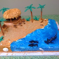 Beach Cake Very fun! Lots of fondant figures, starbursts, tootsie rolls, caramels. Huge hit for a birthday party for a diver!