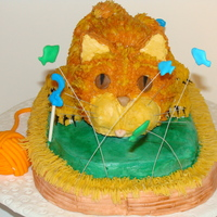 "Annabelle's Cat Fish and ""2""s are run in sugar with royal frosting. Eyes, nails, yarn, and basket are fondant. All the rest is buttercream. HUGE..."