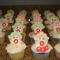 Baby Cupcakes Bottle, teddy bear, and bib baby cupcakes for a baby shower. Cupcakes were a combination of yellow and chocolate cake with white...