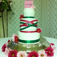 Pink And Green Wedding Cake Red velvet, chocolate, and vanilla cake with buttercream frosting.